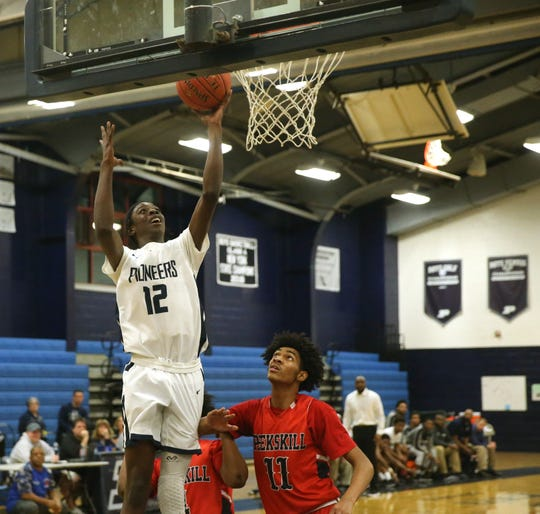 Poughkeepsie's Dejon Hamilton goes up for a layup against Peekskill during Wednesday's boys basketball game.