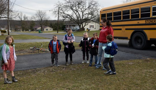 "Angela Danko, creator of ""Frankie Rae's Helping Hands"" will often help out some of her neighbors by getting their kids off the bus and giving them a safe space for a snack, playtime and homework until their parents get home from work."