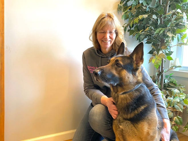 President of MKR9 in Waynesboro, Betsy Ayers, is pictured with Cooper, a German shepherd, that the organization rescued from California.