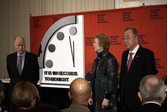 Former California Governor Jerry Brown, executive chair, Bulletin of the Atomic Scientists, left, former President of Ireland Mary Robinson, chair, The Elders, and former UN Secretary-General Ban Ki-moon, deputy chair, The Elders, during a presentation of moving the hands of the Doomsday Clock closer to midnight during an event in Washington D.C. on Jan. 23, 2020. (Bulletin of the Atomic Scientists)