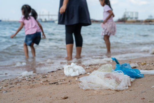 Plastic bags contribute to pollution all over the world, including in cities and on beaches.