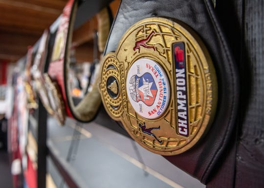 Championship belts like the inside of Team Villa Gym from the number of boxers that've worked with trainer Max Garcia. Ruben Villa will look to defend his latest one, WBO Featherweight International Champion, Friday night in Louisiana. Jan. 15, 2020.