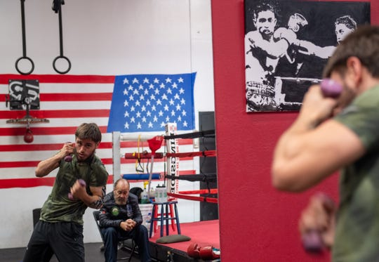 Souvenirs from Villa's previous wins, like the painting next to the gym ring, hang on walls throughout Team Villa Gym in Salinas. Jan. 15, 2020.