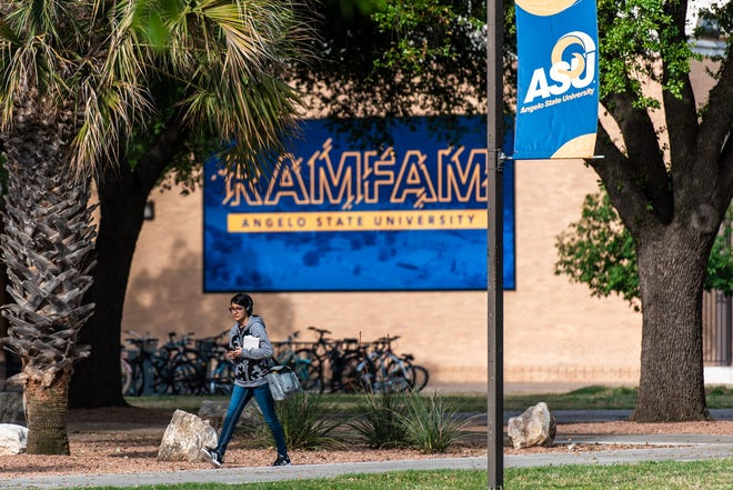 An Angelo State University student walks across campus.