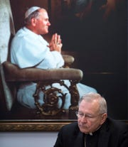 In this Nov. 2, 2018, photo, New Orleans Archbishop Gregory Aymond discusses the release of information on 57 Roman Catholic clergy members credibly accused of abusing minors over the past five decades in southeast Louisiana at the archdiocese offices in New Orleans. An AP analysis of the list of 57 credibly accused clergy found it underestimated the actual number by at least 20. (David Grunfeld/NOLA.com/The Advocate via AP)