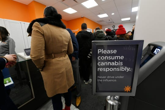 A sign at a Chicago marijuana dispensary as Illinois Lt. Gov. Juliana Stratton purchases recreational marijuana Wednesday, Jan. 1, 2020, the first day Illinois made sales of recreational, or adult-use, marijuana legal.