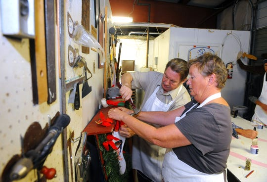 Advocate Glennie Rexrode works with Lynn Lightner. They help create Shenandoah Clubhouse's holiday display for the Festival of Lights on Nov. 17, 2011.