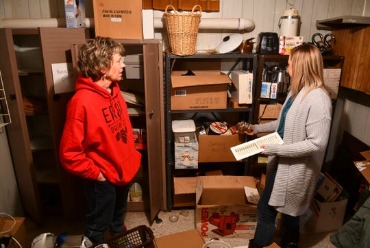 Smart Organizing Solutions owner Julie Braun and her daughter Kelly talk about organizing plans while preparing for a client's upcoming estate sale Tuesday, Jan. 28, 2020.