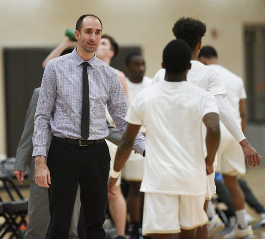 St. Cloud Technical & Community College coach Andy Cone high-fives his players Wednesday, Jan. 29, 2020, at Whitney Rec Center.