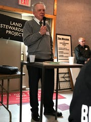 Richard Levins, professor emeritus of applied economics at the University of Minnesota, talks with dairy farmers about potential fixes to the farm crisis at the Greenwald Pub in Greenwald on Thursday, Jan. 30, 2020.
