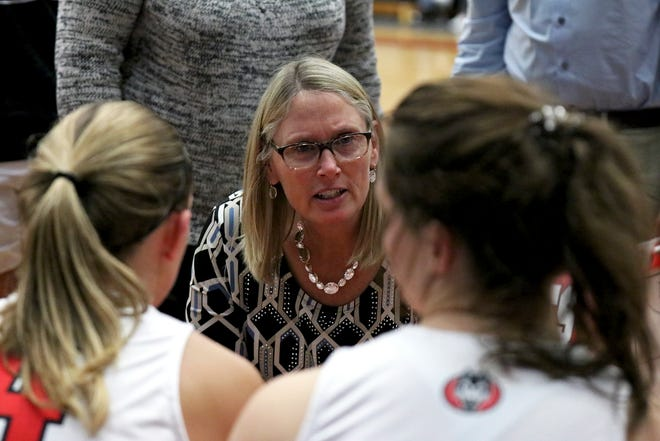 St. Cloud State women's basketball coach Lori Fish speaks with her team during a game against UMD Saturday, Dec. 21, 2019, at Halenbeck Hall.