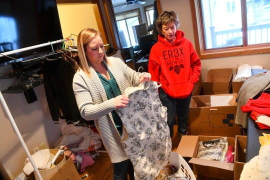 Smart Organizing Solutions owner Julie Braun and her daughter Kelly sort through items while organizing for a client's upcoming estate sale Tuesday, Jan. 28, 2020.