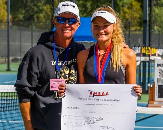 Desert Hills' junior Tia Turley (right) celebrates after her second-straight undefeated season and second-straight individual state title.