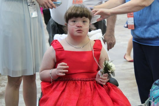 Kimmy Harvin got to wear her red dress to last year's Night to Shine. It would be her last prom to dance. In December Kimmy passed away at the early age of 16 due to health complications.