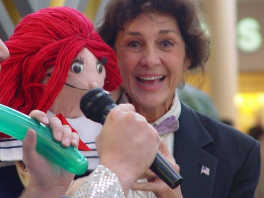 Jan Kaufman and one of her puppets.