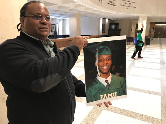 Harvey Johnson holds a picture of his son, 22-year-old Jamee Johnson, following a new conference on Jan. 30, 2020, at the Capitol. Harvey Johnson and family members were joined by members of the Legislative Black Caucus in asking FDLE to investigate the fatal police-involved shooting of Jamee in Jacksonville.