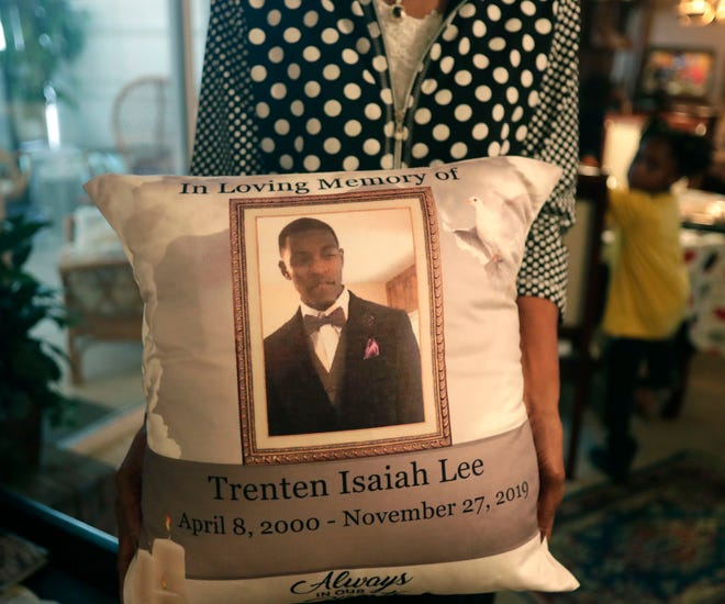 Cathy Wright, who is the grandmother of Trent Lee, a 19-year-old who was shot and killed leaving the North Florida Fair in November 2019, holds a pillow with a photograph of her grandson.