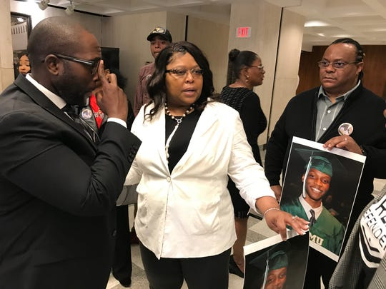 State Rep. Shevrin Jones (left) meets with Bridget Johnson (center), stepmother of slain former FAMU student, Jamee Johnson, and Jamee's father, Harvey Johnson, following a news conference Jan. 30, 2020 at the Capitol. At back is Kimberly Austin, Jamee's mother.