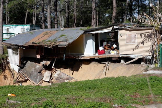 Anwar El Khouri, 74, has lived in a trailer off Capital Circle Southwest for 11 years. On Tuesday a sinkhole opened up next to his home. By Thursday morning the sinkhole had grown to be larger than 50-feet wide and has begun to swallow his home and belongings.