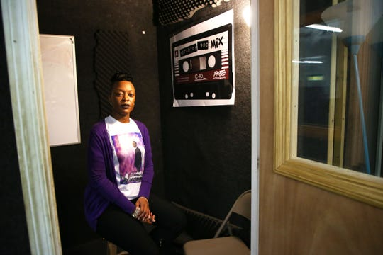 Coressa Reed, who is the mother of Trent Lee, a 19-year-old who was shot and killed in November, poses for a photo inside the recording studio at the Palmer Munroe Teen Center where her son once recorded music.