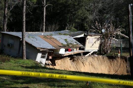 Caution tape has been placed as a barrier to prevent people from getting too close to a large sinkhole in the Capital Circle Pines trailer park. Anwar El Khouri, 74, has lived in his trailer off Capital Circle Southwest for 11 years. On Tuesday a sinkhole opened up next to his home, by Thursday morning the sinkhole had grown to be larger than 50-feet wide and has began to swallow his home and belongings.
