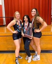 Jensen Beach's three regional champions (from left) Morgan Wiswell, Jessica Rosenberg and Naiya Sawtelle pose with the Region 1-8A girls weightlifting championship trophy. The Falcons won their first regional title at Frostproof High School on Wednesday.