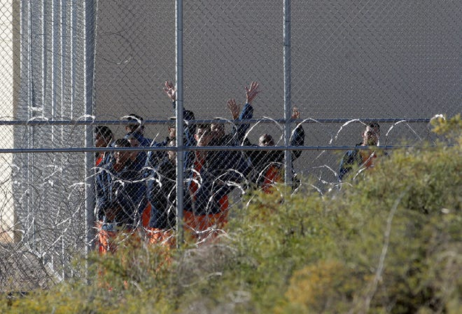 Migrants housed at the Otero County Processing Center walk through the yard Tuesday. Some Cuban detainees are staging protests at the facility.