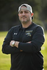 Dustin Croick, 34, has returned to Agoura High as the school's new head football coach. Croick starred at quarterback for the Chargers in high school before playing at Iona College.