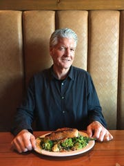 Ron Parker, founder and owner of Bandits' Grill & Bar in Camarillo and Thousand Oaks, poses with his usual order from the restaurant's menu: the anti-salad protein plate.