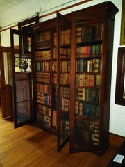 One of the primary tasks undertaken at the Vineland Historical and Antiquarian Society Museum while it was closed in January was cleaning inside the Charles K. Landis bookcases. An assortment of photographs and other material was often discovered hidden between the pages of the books.