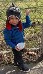 Jonah Nichols, 2, of Upper Deerfield, poses with the peanut butter and bird seedpinecone he made during a Wee Read Program at Cumberland County Library. The library is at 800 E. Commerce St., Bridgeton. For information, call (856) 453-2210.