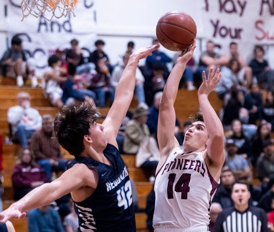 Redwood's Conner Gilcrest pressures Mt. Whitney's Camron Scattareggia in a West Yosemite League high school boys basketball game on Wednesday, January 29, 2020.