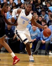 Suffern's Clevmer Lubin (5) pushes the ball past North Rockland's Tahir Alexandre (0) during boys basketball game at Suffern High School on Jan. 29, 2020. Suffern defeats North Rockland 45-33.