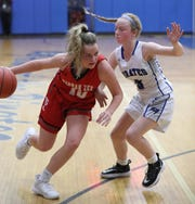 Tappan Zee's Dana Phelan drives on Pearl River's Maggie McGrane during their game at Pearl River Jan. 29, 2020. Tappan Zee won 62-55.