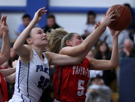 Pearl River'sJenna Daly, left, fights for the ball with Tappan Zee's Kellie Linehan during their game at Pearl River Jan. 29, 2020. Tappan Zee won 62-55.