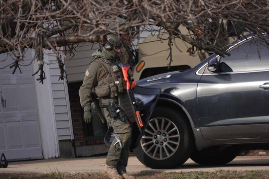 Delaware State Police respond to a standoff in the Penn Acres South development on the unit block of Bunker Hill Road on Thursday morning.