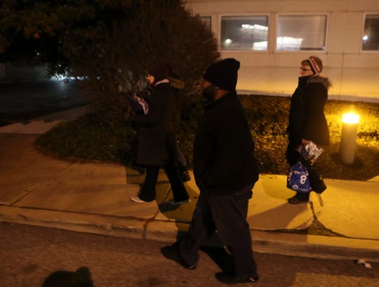 Advocates for the homeless (from left) Laura Kullcek, Kerry Sheldon (obscured), Shane Cannon and Sara Weimer make up one of many teams that swept areas statewide looking for people without housing during an annual state-wide census Wednesday night.