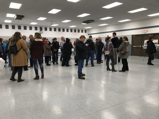 Saratoga residents ask questions about a proposed solar project during an open house Wednesday at the Saratoga Town Hall.