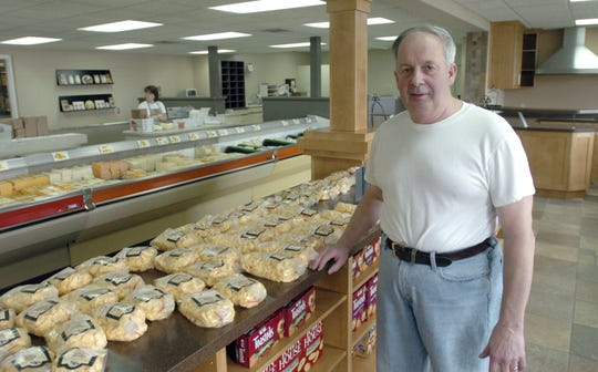 Mike Moran, co-owner and then-president of Wisconsin Dairy State Cheese Co. in Rudolph, stands in front of a cheese curds display on the sales floor in this 2006 file photo.