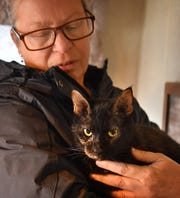Kimber Hopkins, founder and president of Emily's Legacy Rescue, holds Matilda, a cat waiting to be fostered through the nonprofit.