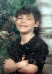 Michael Derwacter was shot and killed in an alley behind his aunt's house on July 28, 2002. The 9-year-old was riding his bike at the time.