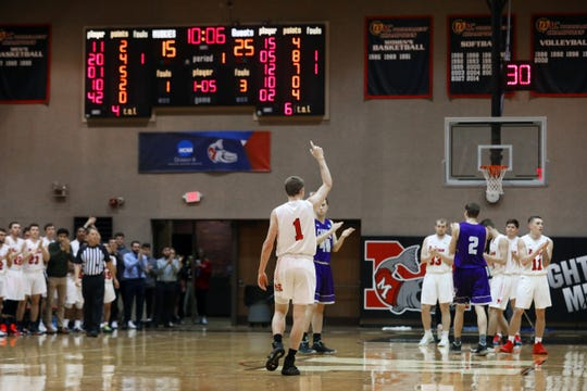 Muskingum University's Marcus Dempsey acknowledges the crowd after breaking the school's scoring record Wednesday night during the Muskies' game against Capital University. The Tri-Valley High School graduate passed the record with his fifth point of the game, breaking 1992 graduate Andy Moore's record of 1,871 points.