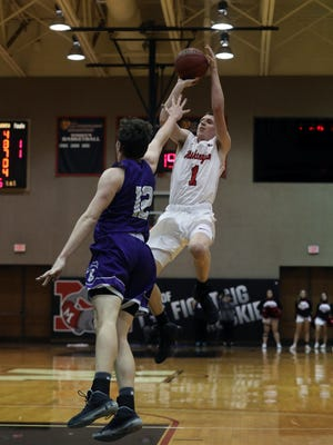 Muskingum University's Marcus Dempsey fires his record-breaking shot during the Muskies' game against Capital University Wednesday night. Dempsey, a Tri-Valley High School graduate, became the Muskies' all-time leading scorer with the shot.