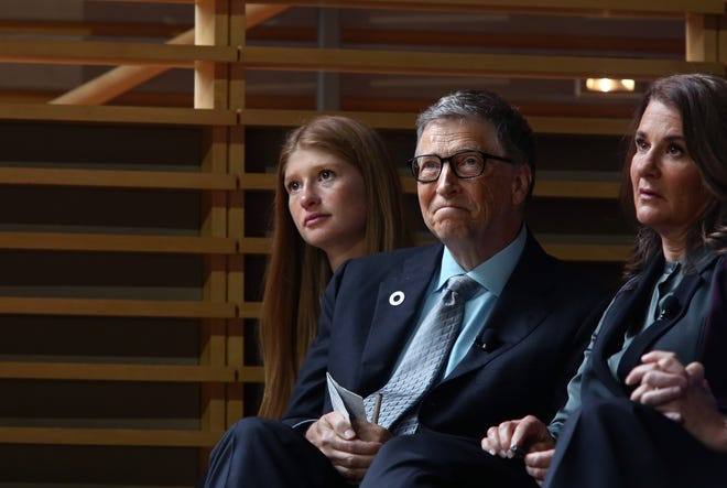 Jennifer Gates and her parents, Bill and Melinda Gates, listen to former U.S. President Barack Obama speak at the Gates Foundation Inaugural Goalkeepers event on Sept. 20, 2017 in New York.