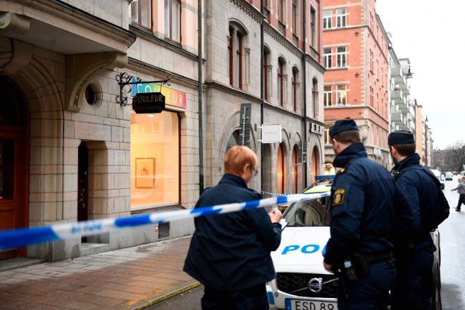 Police officers stand in front of the Couleur gallery where exhibited Salvador Dali sculptures have been stolen by, according to the Police, at least two thieves who smashed the entrance window setting the alarm off at 4 a.m. on Jan. 30, 2020, in Stockholm, Sweden.