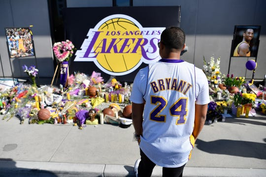 Fans pay their respects at a makeshift memorial for Los Angeles Laker great Kobe Bryant at Los Angeles Lakers Training Facility. Bryant, who played his entire career with the Lakers, died with his daughter and 7 others in a helicopter crash Sunday Jan. 26, 2020.