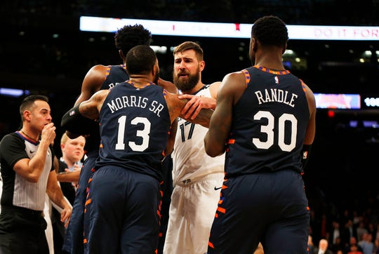 Memphis Grizzlies center Jonas Valanciunas and New York Knicks forward Marcus Morris during the late-game scuffle between the teams.