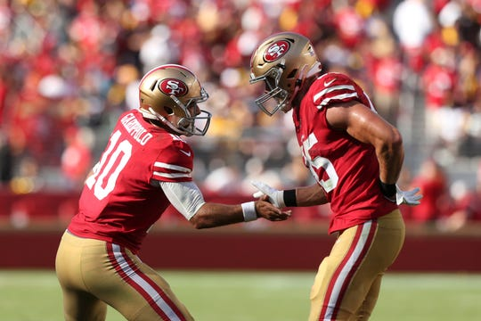 San Francisco 49ers quarterback Jimmy Garoppolo (10) celebrates with tight end George Kittle (85) after a touchdown against the Pittsburgh Steelers.