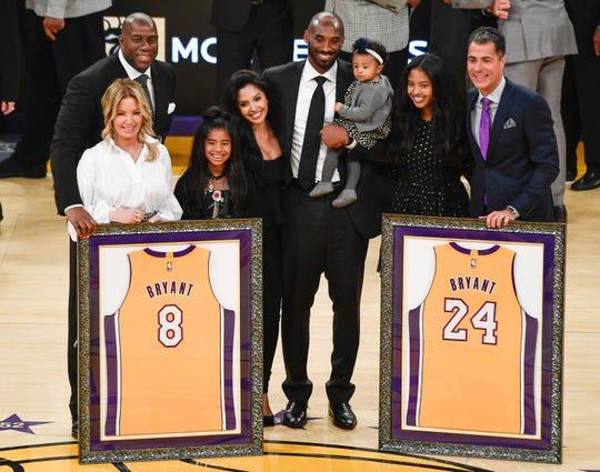 Magic Johnson, Jeanie Buss, Gianna Bryant, Vanessa Bryant, Kobe Bryant (holding Bianka Bryant), Natalia Bryant and Rob Pelinka during Kobe's jersey retirement ceremony in 2017.