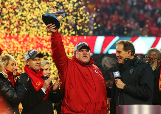 Jan 19, 2020; Kansas City, Missouri, USA; Kansas City Chiefs head coach Andy Reid celebrates with the Lamar Hunt Trophy after defeating the Tennessee Titans in the AFC Championship Game at Arrowhead Stadium. Mandatory Credit: Jay Biggerstaff-USA TODAY Sports